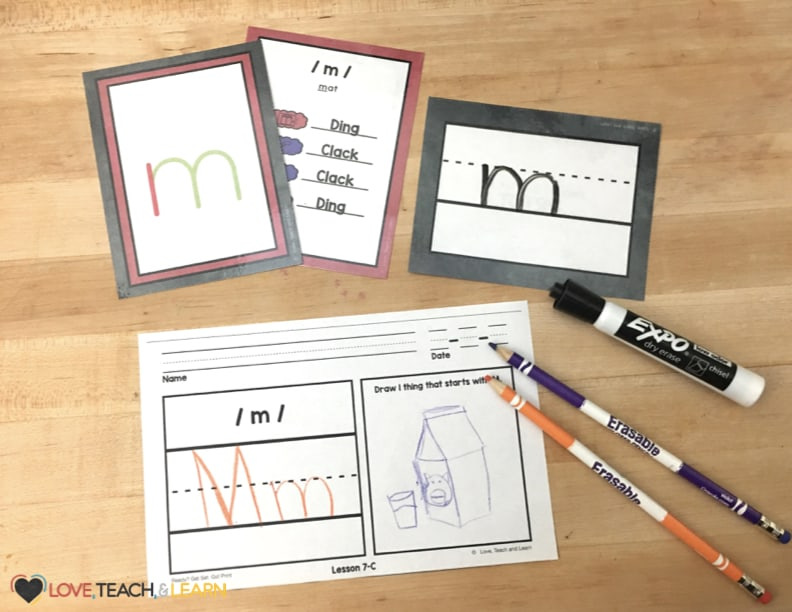 Reviewing phonics and proper letter formation with phonogram cards and a picture activity.